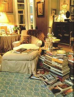 (via rug, books, art, dark furniture, chair & ottoman … | i n t e r i o …) Looks exactly where my daddy sits surrounded by books.