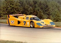 Yellow Car - Brian Redman steering the Cooke Woods Lola at Road Atlanta in the Fall of Photos by Mark Hansen Road Race Car, Road Racing, Sports Car Racing, Sport Cars, Auto Racing, Ferrari, Brian Redman, 24 Hours Le Mans, Le Mans Series