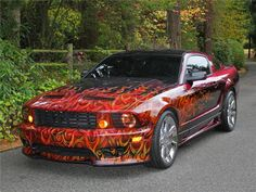 A full Saleen body kit has been added and the car is painted a custom pearl red/green/blue chameleon paint with hand painted flames airbrushed on the front end. Description from barrett-jackson.com. I searched for this on bing.com/images