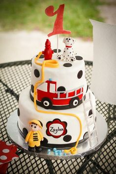 Fireman cake by Sweet Confections for a little boy's 1st bday.