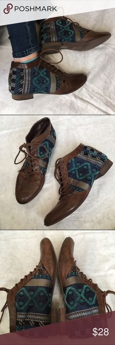 Navajo print ankle boots Faux brown leather boots with Navajo print fabric on the sides. These ankle boots will dress up any plain outfit! Forever 21 Shoes Ankle Boots & Booties