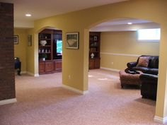 Hiding poles and ductwork can be a real design challenge in finishing off your basement.  Ideally you want to try and design the rooms to hide the posts in the walls, but that doesn't always workout.  Here are a couple ideas to make the poles feel like they have a purpose in the design.