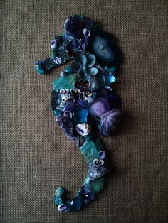 Each one of our Mosaic Seahorses is a unique one of a kind piece. By ordering an Amethyst Seahorse you will receive one Mosaic Seahorse in similar shades of Turquoise & Violet and created with the same materials which include amethyst clusters, crystals & stones, amazonite, tanzanite, turquoise, fuc