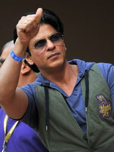 Bollywood actor and owner of Kolkata Knight Riders team Shah Rukh Khan greets the crowd during the IPL Twenty20 cricket match between Royal Challengers Bangalore and Kolkata Knight Riders at the M. Chinnaswamy Stadium in Bangalore on April 10, 2012.