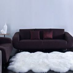 """Handmade sheepskin wool rug.  Product: RugConstruction Material: Sheepskin woolColor: NaturalFeatures: HandmadeDimensions: 6' x 7'5""""Note: Size is approximate. Please be aware that actual colors may vary from those shown on your screen. Accent rugs may also not show the entire pattern that the corresponding area rugs have.Cleaning and Care: Spot treat with a mild detergent and water. Professional cleaning is recommended if necessary."""