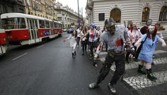 Enthusiasts, dressed as zombies, march through central Prague during a Zombie Walk procession on May 5, 2012.