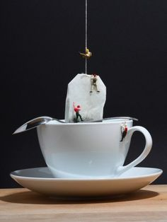 Tea cup, tiny people. Miniature photography