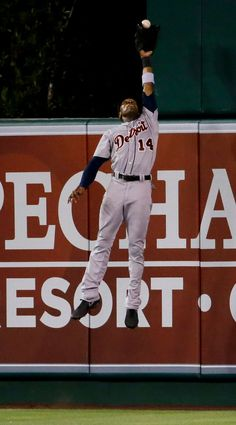 Austin Jackson robs Los Angeles Angels' Kole Calhoun of a home run during the seventh inning, 07/24/2014