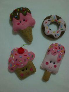 Esse kit tem 4 imãs divertidos em formato de doces. Produzido em feltro,com aplique de canutilhos e enchimento de fibra siliconada. MEDIDAS: -Sorvetinho: 11x7 -Picolé: 11x5 -Donut: 7cm de diâmetro  -Cupcake: 8x8 R$ 38,00