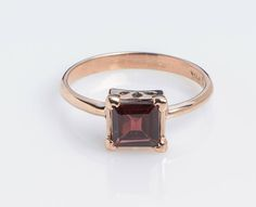 Check out this item in my Etsy shop https://www.etsy.com/listing/530285449/square-handmade-ring-with-garnet-in-14k