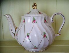 Vintage Sadler Teapot China Roses England.  I absolutely am OBSESSED with this teapot. Don't know why.