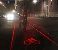 he Bike Lane Safety Light features two red laser lights that project lanes onto the road in front of you, giving you a visible marker for keeping your bike where it should be. The attached red LED lights tell others where you are and provide visibility for up to one mile. Check it out! ☝☝☝