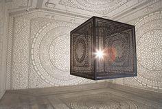anila quayyum agha casts a delicate web of shadows with a single light bulb