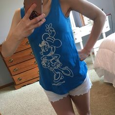 Minnie Mouse tank top! This is a blue tank top with Minnie Mouse embroidered on it in white stitching. Official merchandise from Disney World. In great shape. Love the product but not the price? Make an offer, I'll consider all offers :) Disney Tops Tank Tops