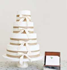 Pretty White Wedding Cake with Burlap and Bows