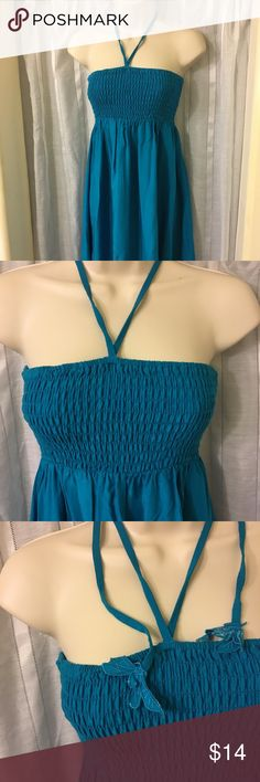 Dark teal summer tube top style dress. Forever 21 Mid-length teal dress. Cute dragonfly tie accent. Lace burnout detail along bottom. Hits about 1.5 inch above knee. Great color. Tube top on upper portion makes it nice and fitted. Forever 21 Dresses
