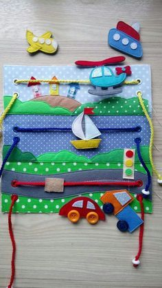 Quiet book page with boat, car and helicopter
