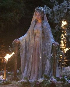 Tristan and Isolde wedding. lavender...rosemary...baby's breath...lots of flames...greenery at the end of aisles and branches/greenery similar to photo all around alter area