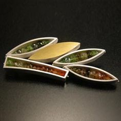 """This modern leaf-form brooch was fabricated by hand using sterling silver, 18k bi-metal and multi-color, semi-precious stones. 2.5"""" x 1.5"""" x .25"""" Made to order, ships within 6 weeks. by Ashka Dymel"""