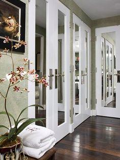love! Good idea for a small bedroom - closet doors.