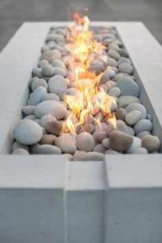 Avera Concrete Gas Firepit Like the river rock. Matches our outdoor shower floor....just need to tone down modern elements