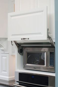 microwave shelf with hinged door