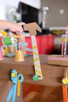 A DIY Workshop made it of cardboard. Incredibly colorful and details DIY project for families.