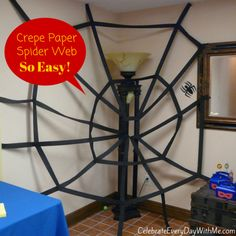 Easy decor for a superhero party!  Spiderman web - made with crepe paper and tape.