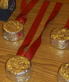 **Update 1/21/2014- Ding dongs don't come in foil anymore. **Pinewood derby 'medal' -- ding dong with ribbon glue gunned to the back