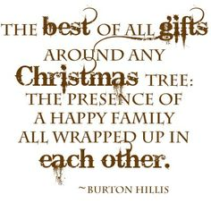 The best of all gifts around any Christmas tree: The presence of a happy family all wrapped up in each other. Burton Hillis