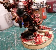 """Added some """"Blood for the blood god"""" technical paint to the model."""