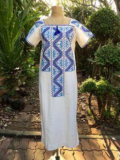 A personal favorite from my Etsy shop https://www.etsy.com/listing/493095610/oaxacan-maxican-huichol-sikuli-dress