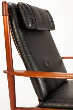 Lounge Chair PJ56 Teak and Leather by Grete Jalk | From a unique collection of antique and modern lounge chairs at https://www.1stdibs.com/furniture/seating/lounge-chairs/