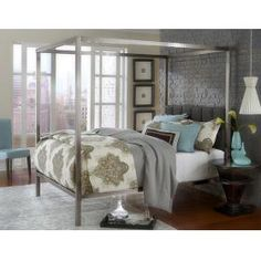 Modern style meets contemporary cool in the Chatham Canopy Bed. Finished in a matte, antique nickel and boasting a dusty black, segmented, fabric-covered headboard, the metal Chatham Bed is an old school, romantic canopy bed with modern sensibilities. Available in queen and king sizes.