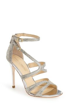 Free shipping and returns on Ivanka Trump 'Hotis' Strappy Sandal (Women) at Nordstrom.com. Curvy, asymmetrical straps wrap the foot in glamorous glitter on a semi-cage sandal made even more memorable with a gleaming metallic heel.