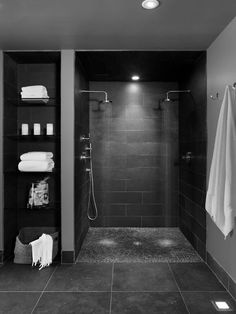 Hello, noir! While I think I'd prefer the lightness of white open spaces for my morning shower, this moody black double shower uses large format shower tile to make the color the focus. I'm surprised they didn't use a charcoal grout, but to each their own. Bathroom shower tile inspiration via www.L-2-Design.com