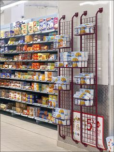 Part decor, part wall armor, Diamond Plate is used as Wainscoting in this Euro-Concept SuperMarket setup provided by CAEM Shelf Engineering. Store Fixtures, Wainscoting, Wine Rack, Euro, Grid, Retail, Shelves, Display, Plate