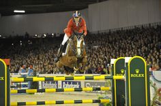 Rich Fellers and Flexible winning the 2012 Rolex FEI World Cup Jumping Final. Photo by Kit Houghton/FEI.