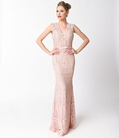 This blush lace gown is perfect for any special occasion! With cap sleeves and a v-neckline this delicate dress is beautifully embellished with pearls and rhinestones. It has built in boning and padding at the bust for support, and an invisible zipper for