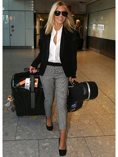 Um, why do we not look like this when we emerge from a long-haul flight? No fair! Mollie King touched down at Heathrow airport looking incredible in this airport ensemble of cropped trousers, a crisp white short and a blazer. Mollie completed her outfit with sleek hair and a pair of sunglasses.