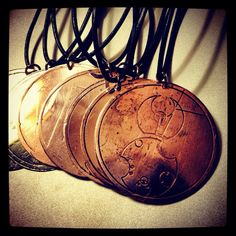 Doctor Who inspired jewelry! Doctor Who Etched Metal Tardis/Gallifreyan Pendant from Cosgrave Studios available on request.