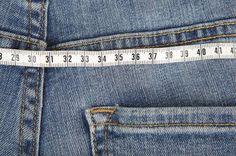 Jeans mit Maßband
