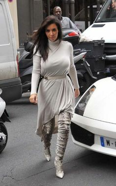 Climbing out of a white Lamborghini, Kim Kardashian and Kanye West were spotted arriving at the APC store for some shopping in Paris, France on Tuesday (June 19).