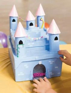 Secret Castle Trinket Box craft from The Princess Craft Book - In The Playroom - Make a secret princess castle from cardboard tubes and boxes The Effective Pictures We Offer You Ab - Cardboard Castle, Cardboard Crafts, Cardboard Tubes, Shoebox Crafts, Toilet Paper Roll Crafts, Paper Crafts, Book Crafts, Fun Crafts, Craft Books