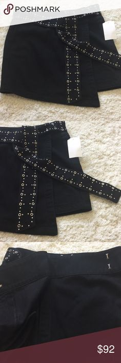 NWOT. Paige Rosie Denim Skirt New black denim skirt with studded belt. Waist 15 inches. Length 15.5 inches. Size 27/28 PAIGE Skirts Mini