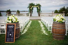 Rustic elegance brings to mind wine country inspired props and décor – like wine bottles, barrels and corks. | Monogamy Wine Blog | Wine Country Wedding Decor Ideas