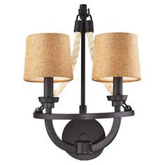 Add a touch of nautical appeal to your foyer or living room with this industrial-chic wall sconce, showcasing rope accents and an aged bronze finish. Prod...