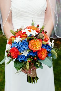 Hayley's bouquet included dark blue hydrangea at the base with her favorite Circus roses, which also compliments the blue very well. There is an accent of chocolate hypericum berries, stephanotois and grey green wheat's. It was bundled together with natural burp ribbon.