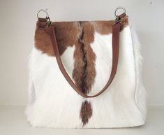 """""""COWHIDE HAIR On HANDBAGS, Unique Bags and Purses, Shoulder Bag in Brown White Hide Hair,Tote Leather Purse with Zipper On Top, Birthday Gift BROWN WHITE COWHIDE Tote Bag in Gorgeous Calf Hair, Cowhide Hair Shoulder Bag, Brown Weekend Tote, Brown Cowhide Bag, Pony Hair Bag, Texas. each piece is one of a kind and forever unique. We hand pick each hide ourselves, selecting only the best pieces for our bags, pre planning the best position to capture the best motif on each hide. For those of us that Brown Leather Handbags, Leather Purses, Leather Store, Cowhide Bag, Unique Bags, Beautiful Bags, Cow Leather, Leather Shoulder Bag, Purses And Bags"""