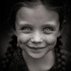 Laughing child with freckles.